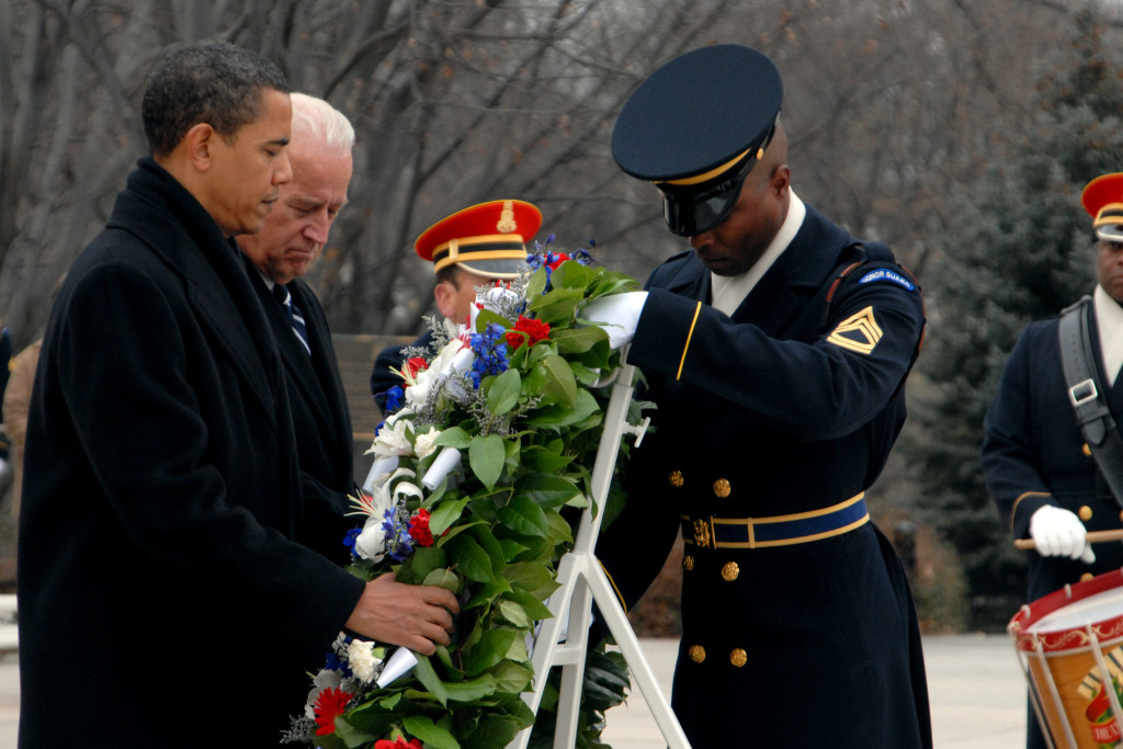 President-elect Barack Obama and Vice President-elect Joe Biden observe a moment of silence while laying a wreath with the assistance of Sgt. of the Guard, Alfred Lanier at the Tomb of the Unknowns in Arlington National Cemetery in Virginia Jan. 18, 2009. President-elect Obama is taking part in inaugural events leading up to his swearing-in ceremony on Jan. 20, 2009. (DoD photo by Sgt. Jeremy Kern, U.S. Army/Released)